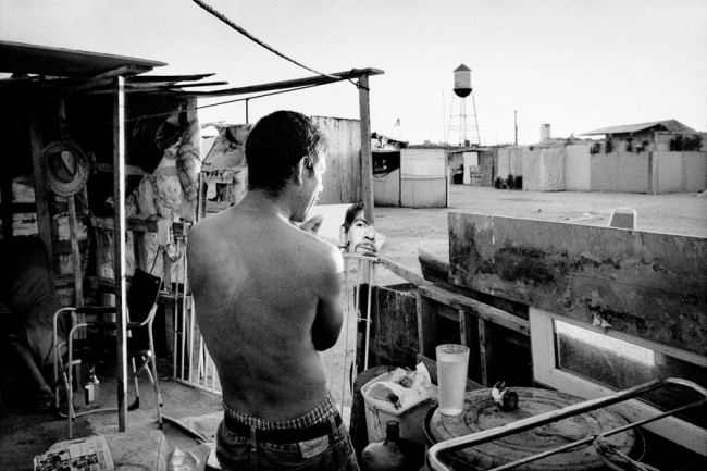 THE DISPOSSESSION Jobless man shaves at his shantytown home.  Fresno, California.